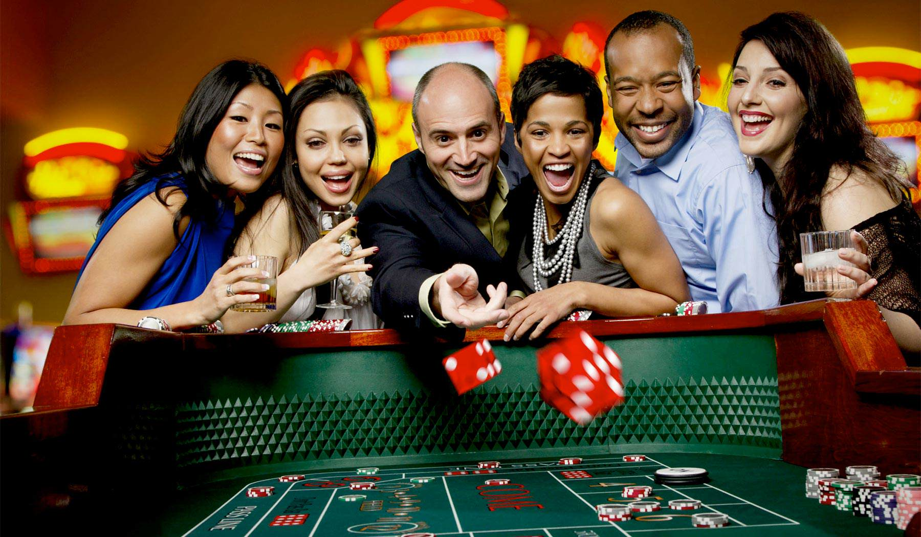 Images of people enjoying gambling at Clearwater Casino